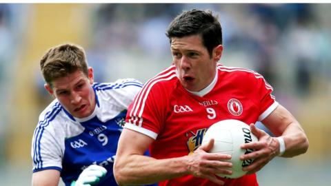 Darren Hughes prepares to challenge Sean Cavanagh as the Red Hands defeat the Farney county