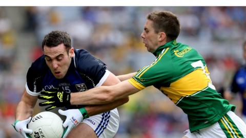 Eugene Keating tries to peel away from Marc O Se during Cavan's quarter-final against Kerry on Sunday