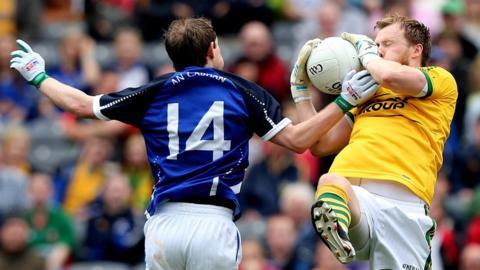 Cavan's Martin Dunne challenges Kerry goalkeeper Brendan Kealy at Croke Park