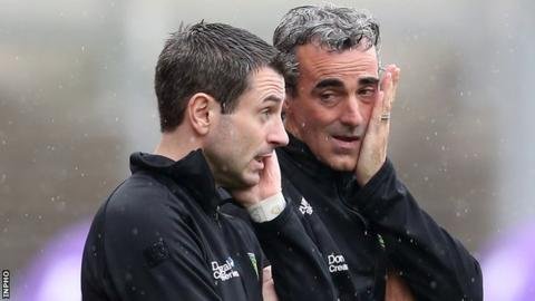 Jim McGuinness and his assistant Rory Gallagher watch as things go all wrong for their team in the All-Ireland quarter-final