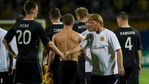 Motherwell players and their manager Stuart McCall