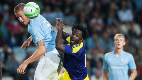 Swansea City striker Wilfried Bony competes for an aerial challenge with Malmo's Pontus Jansson during the Europa League third qualifying round second leg tie.