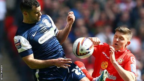 Chris Barker (left) battles with Crewe's Max Clayton