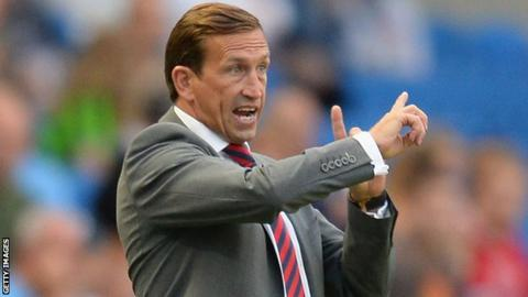 Justin Edinburgh issues instructions to his players at Brighton