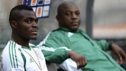 Nigeria's forward Emmanuel Emenike (L) and coach Stephen Keshi