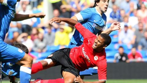 Cardiff striker Fraizer Campbell is brought down by Athletic Bilbao's Mikel San Jose during the pre-season friendly at Cardiff City Stadium.