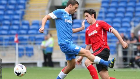 Peter Whittingham takes on Oscar De Marcos during Cardiff City's friendly against Athletic Bilbao.