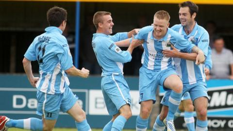 Kenny Kearns celebrates with team-mates after scoring Warrenpoint Town's first goal in the Premiership - but they lost 3-2 to Dungannon Swifts