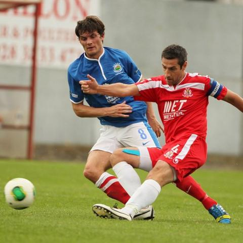Philip Lowry of Linfield in action against Portadown skipper Keith O'Hara during the 1-1 draw at Shamrock Park