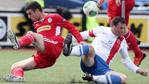 Cliftonville's Joe Gormley competes against James Cully of Ards