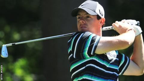 McIlroy watches a shot during the third round