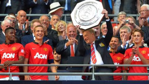 Manchester United manager David lifts the Community Shield after his side beat Wigan