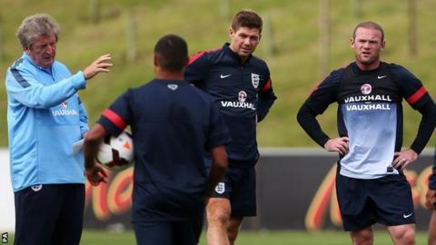 England manager Roy Hodgson (left) and Wayne Rooney (right) during training