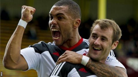 Josh Magennis congratulates Niall McGinn on one of his two goals in the win at Motherwell