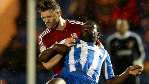 Darren Ward (left) and Jabo Ibehre battle for the ball