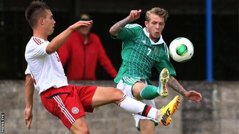 Northern Ireland's Kirk Millar with Denmark's Jonas Knudsen