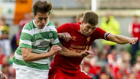 Jackson Irvine tussles with Liverpool's Steven Gerard