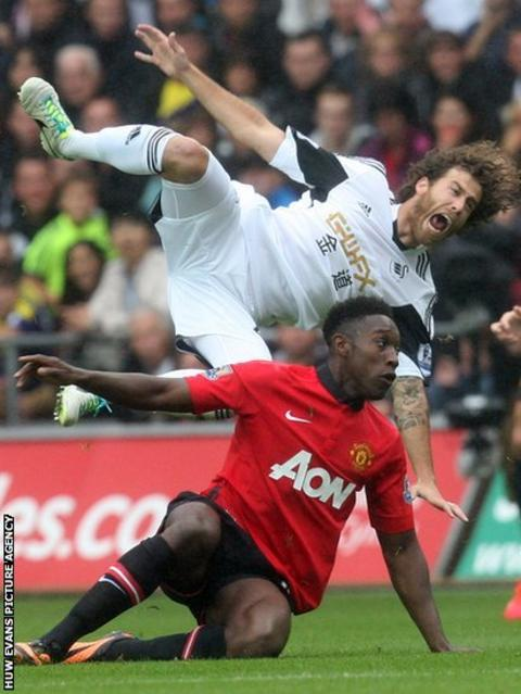 Manchester United's Danny Welbeck brings down Swansea City's Jose Canas in the Premier League at the Liberty Stadium