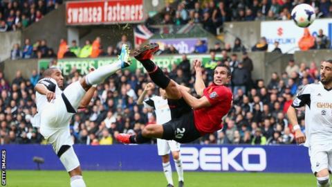 Manchester United striker Robin van Persie scores against Swansea City