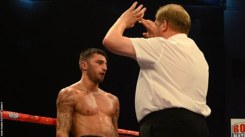 Referee Terry O'Connor steps in to halt further punishment to Cleverly in the fourth round