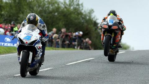 Guy Martin outpaced Bruce Anstey to win the opening Supersport race