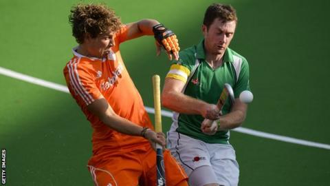 Constantijn Jonker battles with Ireland captain John Jackson in Belgium