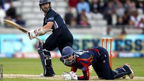 James Foster (right) watches on as Steven Crook bats Northants to victory