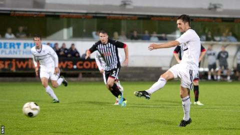 Liam Fox scores a penalty for Raith Rovers against Dunfermline
