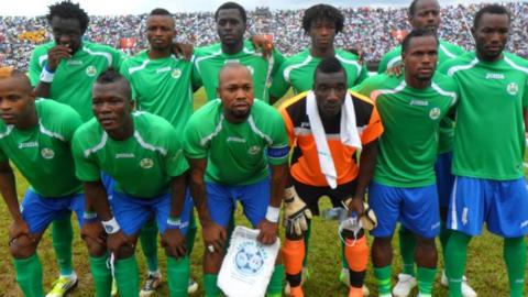 Ibrahim Teteh Bangura (second from left, front row) lines up with the Sierra Leone team