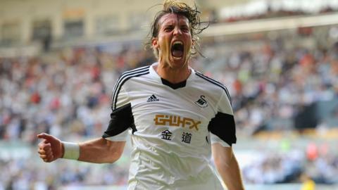 Michu celebrates scoring against Petrolul Ploiesti the Europa League group stage for Swansea City