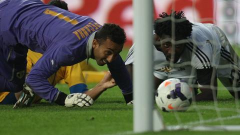 Swansea's Wilfried Bony looks on as the ball crosses the line
