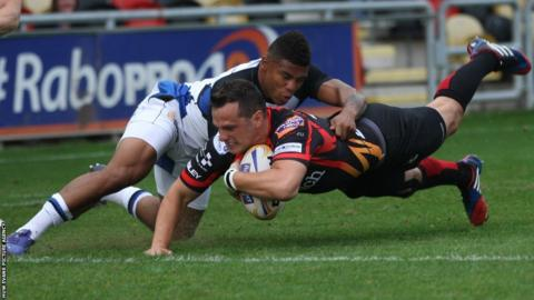 Dan Evans goes over in Newport Gwent Dragons' pre-season clash against Bath at Rodney Parade