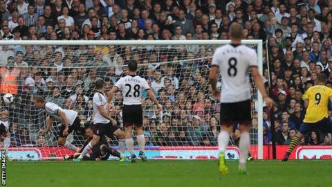 Lukas Podolski (far right) makes it 2-0 for Arsenal against Fulham