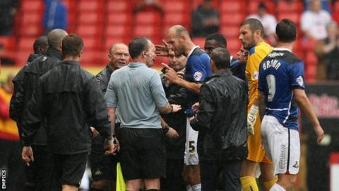 Doncaster's player argue with referee Lee Collins as their game with Charlton is abandoned