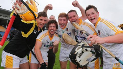 Antrim players celebrate after the final whistle at Semple Stadium, Thurles