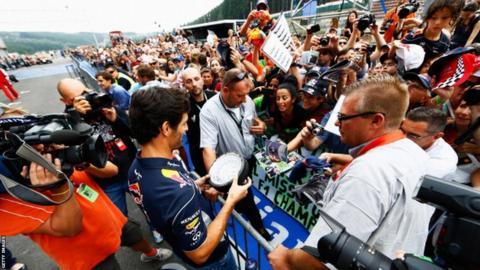 Mark Webber signs autograph for fans