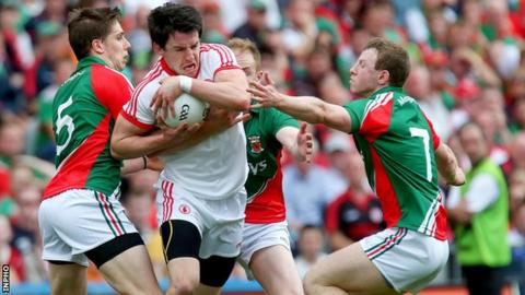 Mayo's Lee Keegan and Colm Boyle with Matthew Donnelly of Tyrone