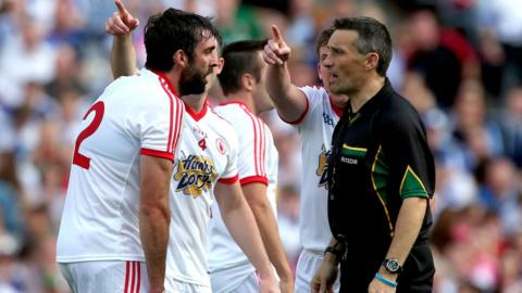 Joe McMahon of Tyrone argues with referee Maurice Deegan after the award of a penalty from which Mayo's Alan Freeman scored