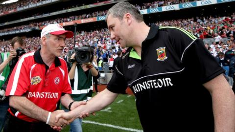 Tyrone manager Mickey Harte shakes hands with his Mayo counterpart James Horan after the game