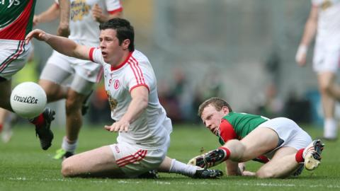 Sean Cavanagh of Tyrone in action against Mayo's Colm Boyle during the All-Ireland Football Championship semi-final