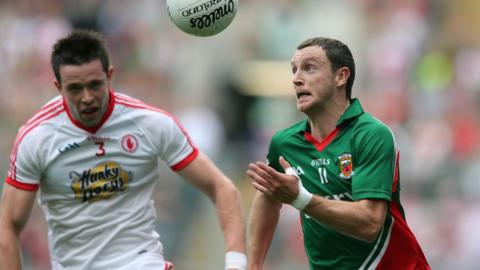 Mayo's Keith Higgins in possession against Conor Clarke of Tyrone