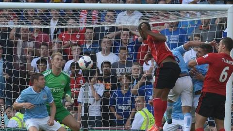 Frazier Campbell scores his second goal and Cardiff's third in the win over Manchester City