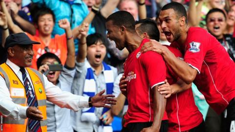 Fraizer Campbell celebrates his third goal in their 3-2 win over Manchester City amid delight from fans, a steward and team-mates