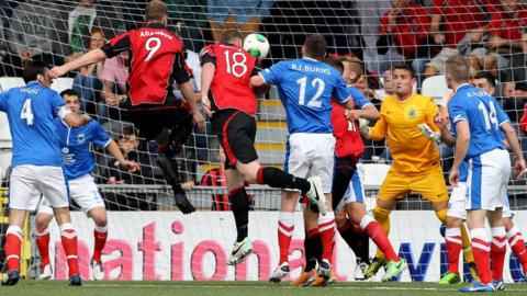 Crusaders striker Jordan Owens heads in one of his two goals in his side's 2-0 Premiership win over Linfield at Seaview