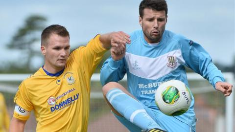 Ryan Harpur of Dungannon Swifts competes against Ballymena United opponent Alan Davidson - the Sky Blues won 2-1