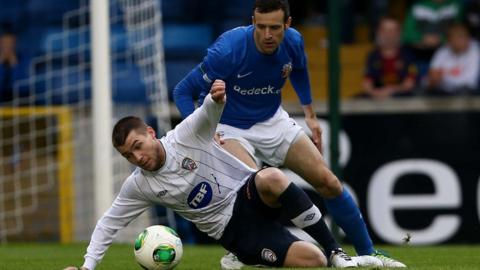 Coleraine's Stephen Lowry keeps his eyes on the ball as Glenavon opponent Ciaran Martyn moves in during the 2-2 draw at Mourneview Park