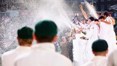 The green caps of Australia look on as England celebrate. England have now won four of the last five Ashes series.