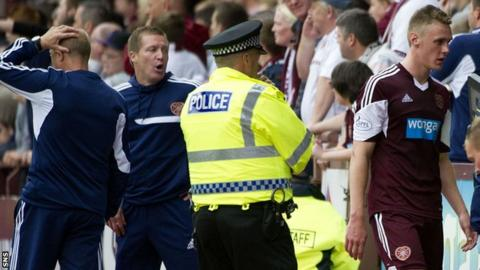 Gary Locke watches Kevin McHattie leave the field
