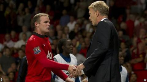 Wayne Rooney (left) shakes hands with David Moyes