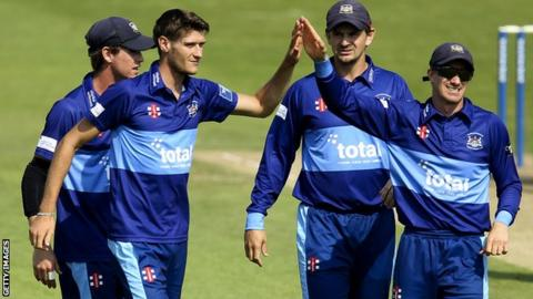 Gloucestershire team celebrate taking a wicket